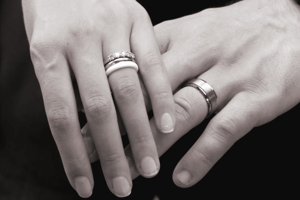 A married couple's hands with wedding rings